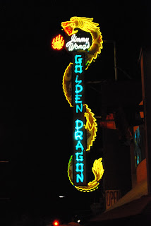 phto of Jimmy Wong's golden dragon neon sign at night