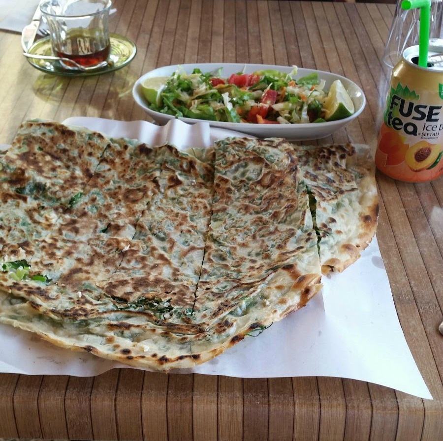 Eating turkish gozleme pancakes