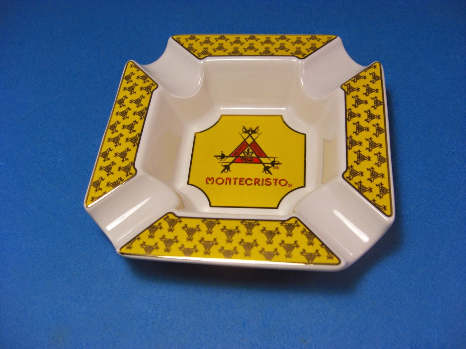 http://bargaincart.ecrater.com/p/22052065/montecristo-yellow-and-white-cigar-ashtray