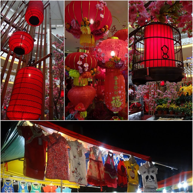 All sorts of red lanterns and traditional costume for children for Chinese New Year in Malaysia