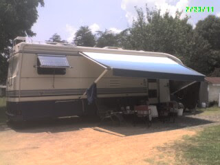 RV with awning out & table & chairs ready
