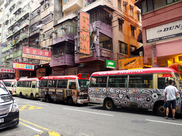 Red top minibuses in the streets of Mong Kok, Kowloon, Hong Kong