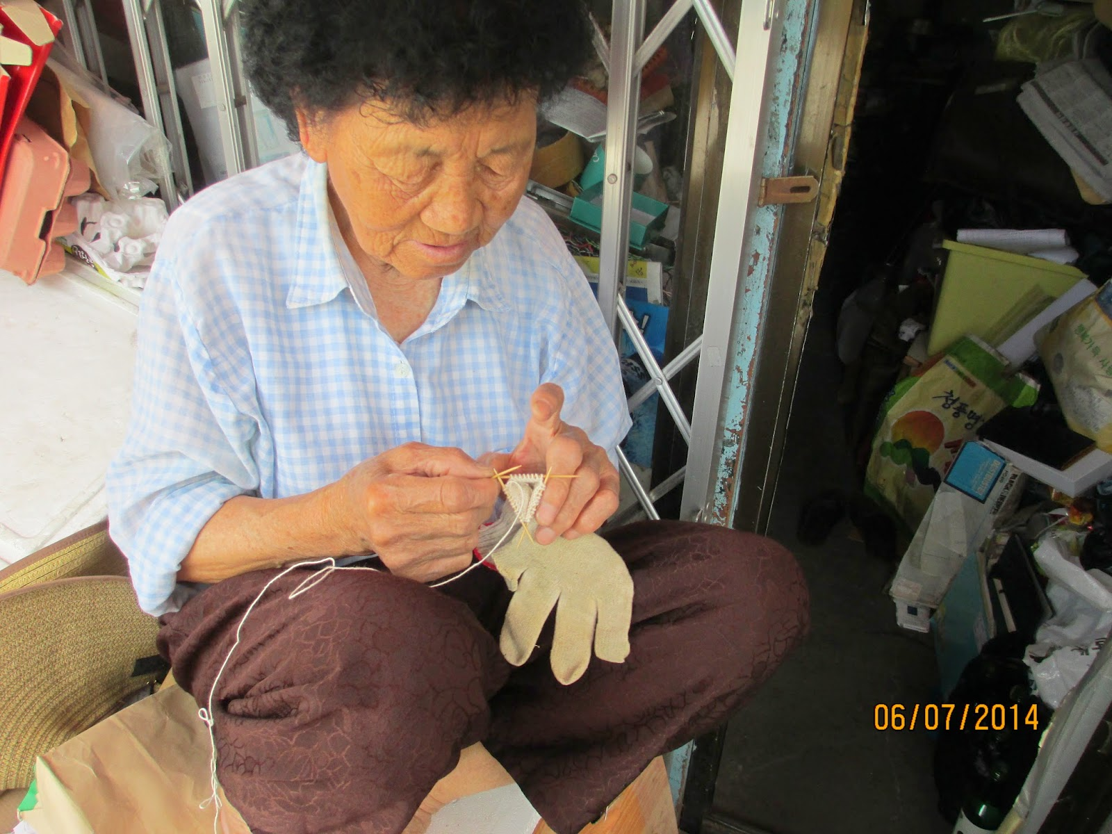 The grandma who lives right outside our church. She was sewing a glove back together with toothpicks! So cool! :)