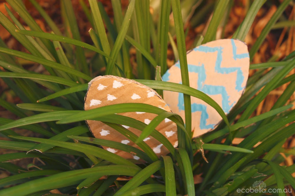 cardboard easter eggs hiding in the grass for a chocolate free easter hunt game