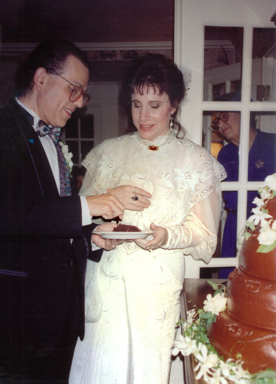 The wedding of Leslie Harris and David Ocker, we share the first piece of chocolate wedding cake