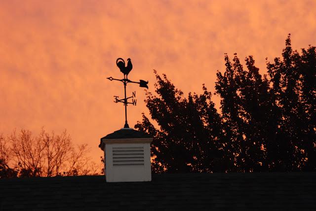 sunset photos of weather vein