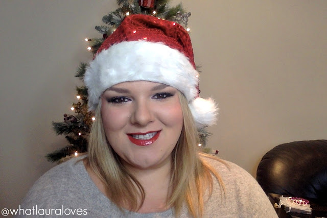 Blonde blogger whatlauraloves wearing santa hat