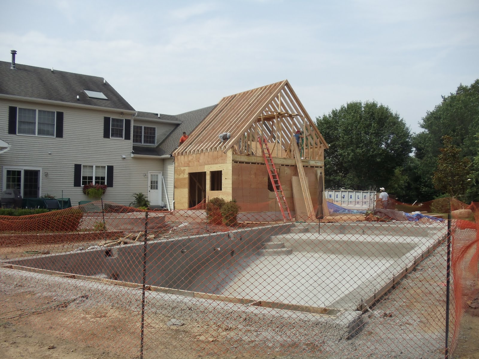 A e construction 39 s blog update a e pool house addition for Pool house additions