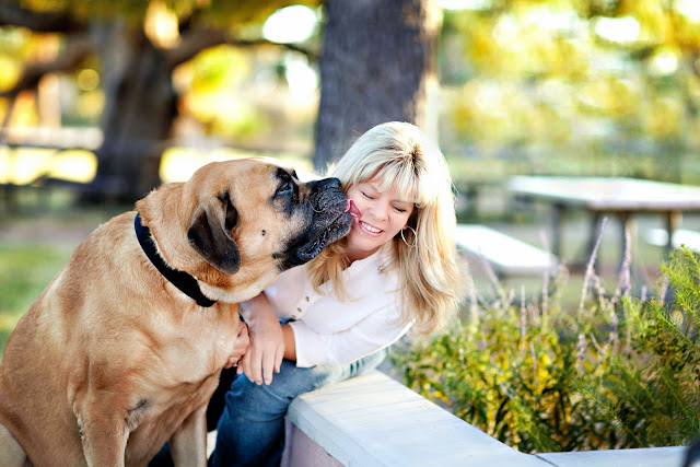 Candid portrait of a dog kissing a local Tucson woman