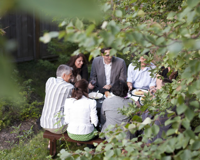Guests eat five courses in a garden at the secret location