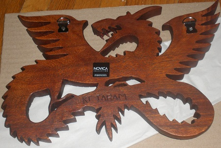 Back of the wooden dragon sculpture from NOVICA.