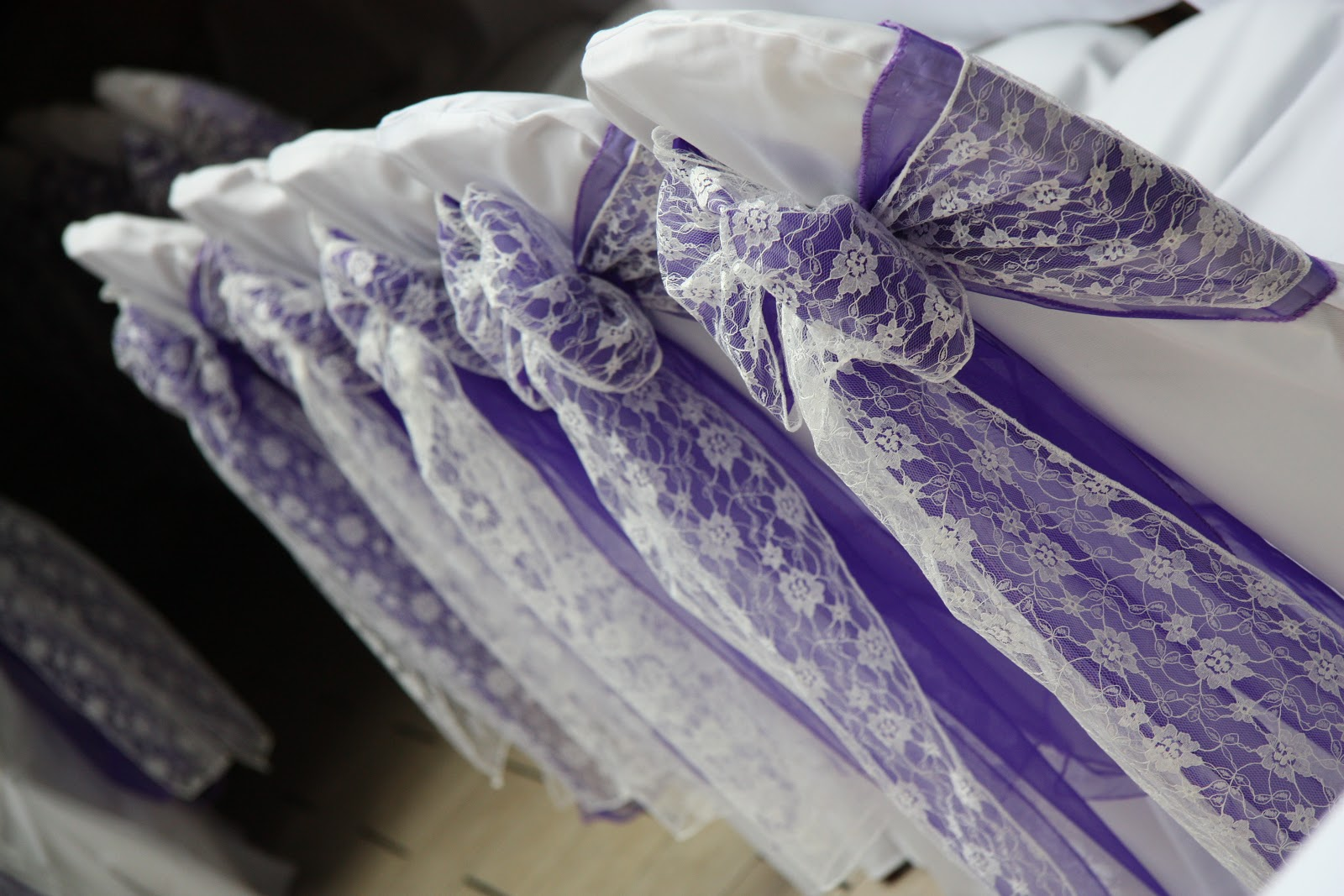 posh chair covers and bows cadbury purple lace sashes a winning