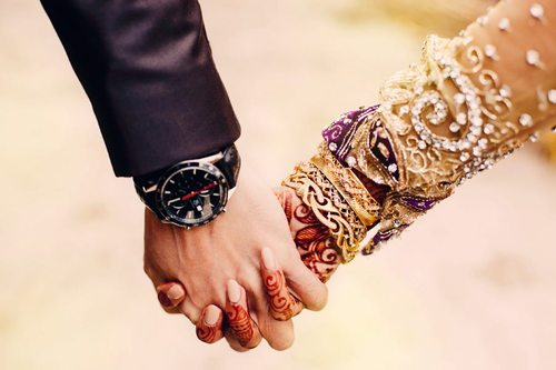 Punjabi Marriage Couple Holding Hands and groom holding hands