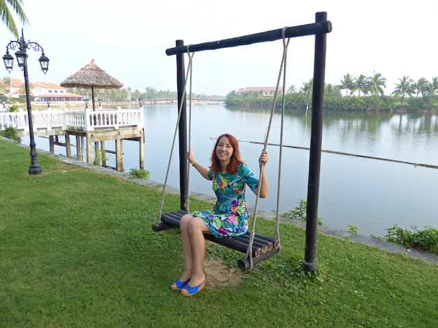 Enjoying at the bank of the river on Riverbeach resort and residences premises in Hoi An