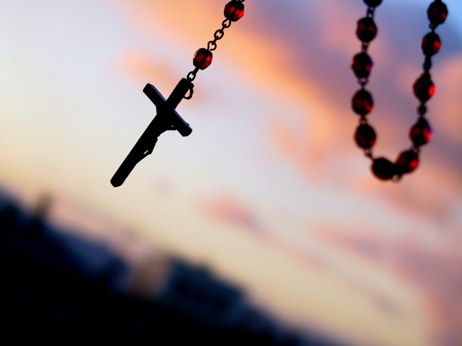 Lyme Disease can be a blessing in disguise being symbolized by this rosary in the sky on the photo