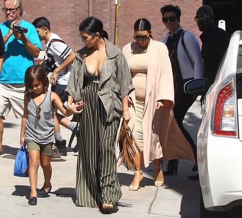 Her belly is growing! Kim Kardashian with round baby ball