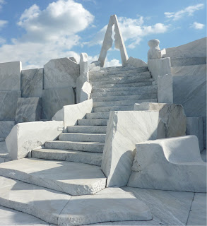 "Stairs made out of marble leading up to the pinnacle of ""The Heights of Eternal Hope for the Future"" with the abstract ""Tower of the Light"" marble statue at the top, At Kosanji Temple"
