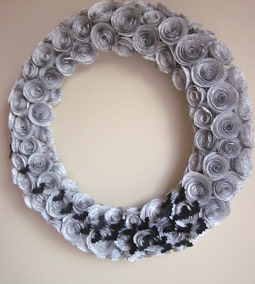 book page rosettes made into a wreath decorated with paper bat silhouettes