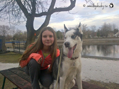 My daughter posing with my Siberian Husky
