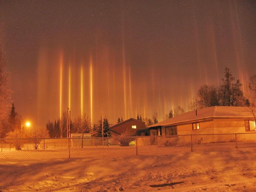 light pillars loom over frosty night skies - snow addiction