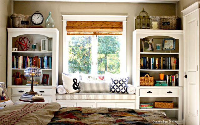 Built in bookshelves in master bedroom with window seat via www.goldenboysandme.com