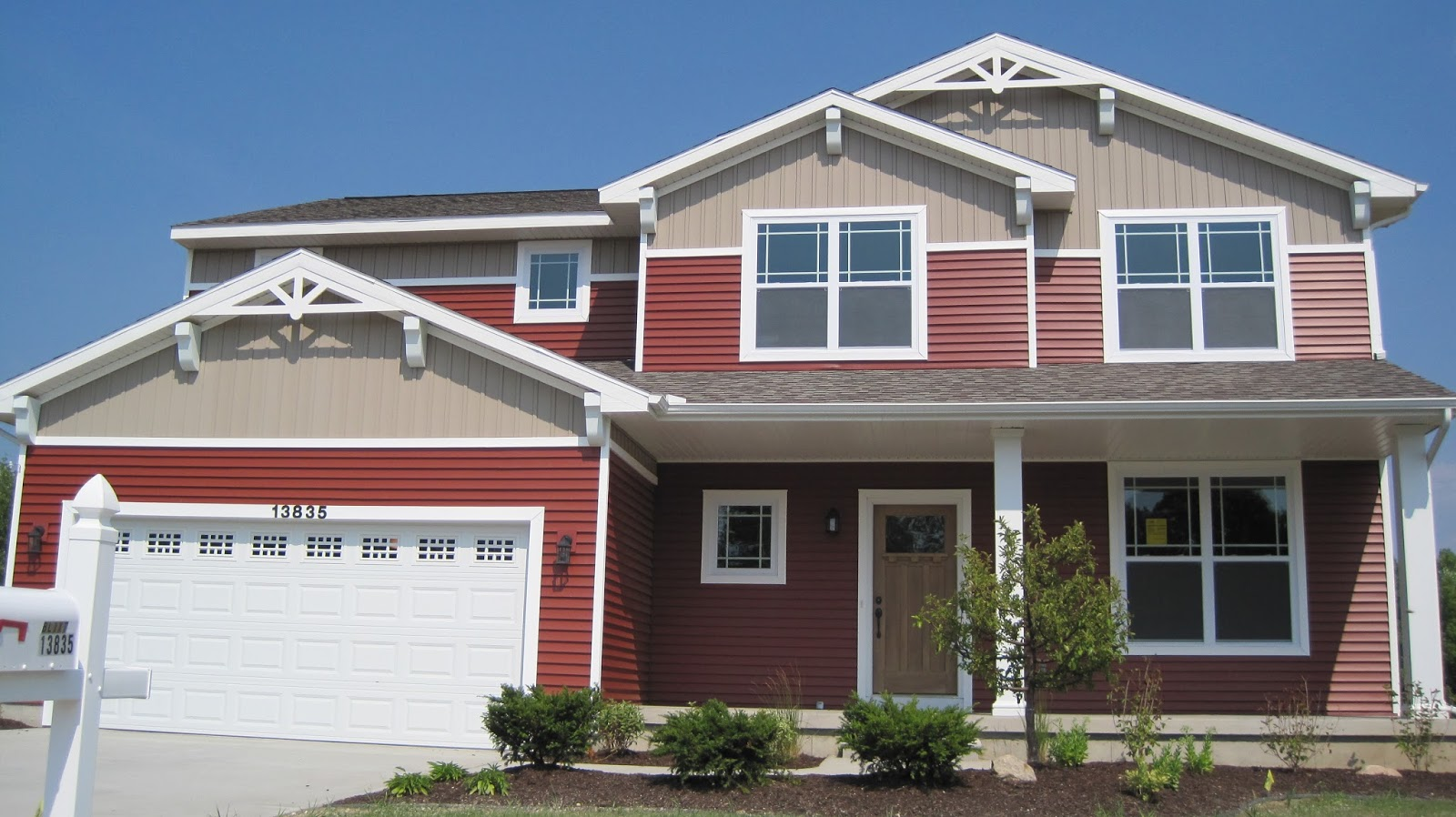 Red with White Trim and Siding House