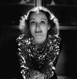 Vintage black and white photo of actress Joan Crawford.