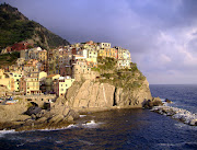 Domani partirò con un viaggio organizzato con destinazione Cinque Terre. (cinqueterre)