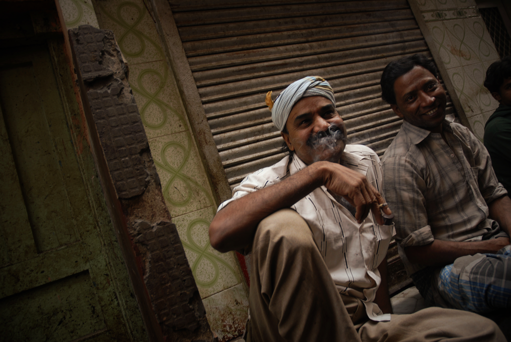 This is an India photo of men laughing in Delhi