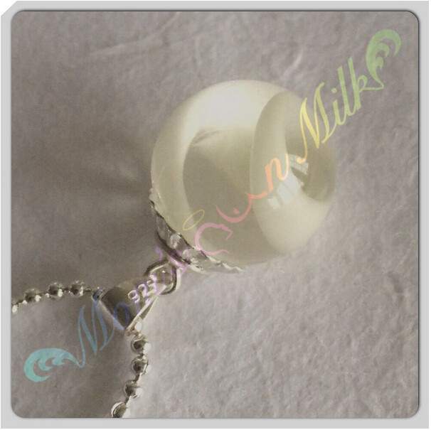 Woman employing milk production jewelry pictures