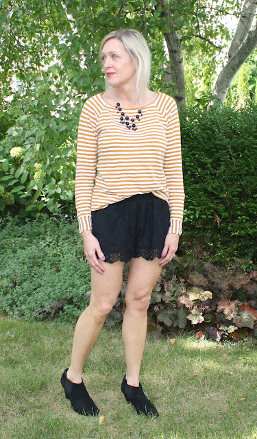 amber striped top, black lace shorts, black booties