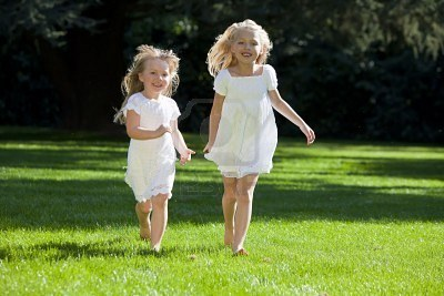 Little Girls Running through a field 2