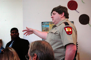 Crime Prevention Specialist Richard Stein of the Montgomery County Sheriff's Office talks to staff from New Danville.