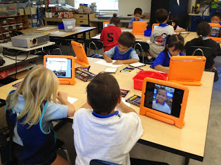 Students using iPads in classroom.