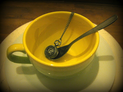 Tea time: clock in the tea cup