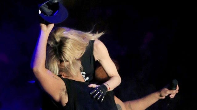 Madonna's kiss injured by rapper.