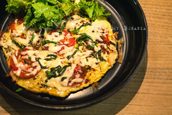 Italian Omelette - Omelette base topped with cherry tomato confit, mozzarella cheese, fresh basil & oregano (Culinary Bonanza)