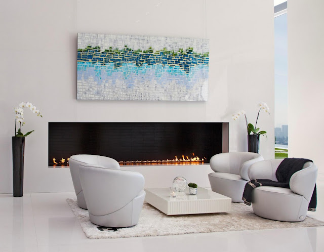 Modern fireplace and sitting area in front of it