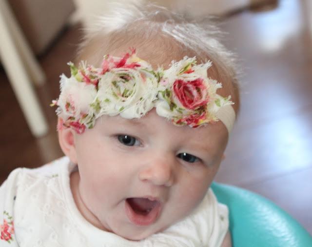 baby girl wearing cute floral shabby chic headband and yawning