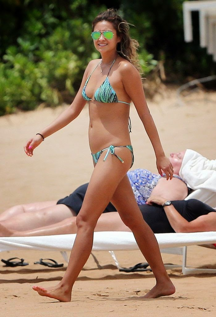 Ashley Benson took advantage of the temperatures at Maui beach on Monday, June 30, 2014 as she frolicked in the seashore with Shay Mitchell.