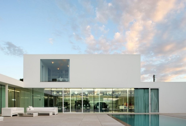Garage of Minimalist Home by Beel & Achtergael Architects from the backyard