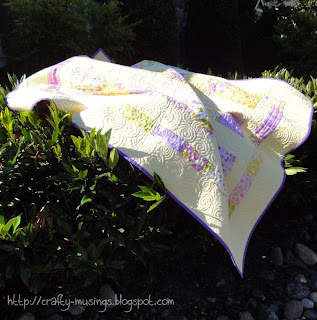 Eden Baby Quilt, artistically draped on my front bushes