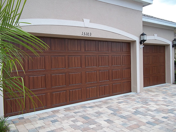 Paint your own garage door to look like wood everything for Wood looking garage doors
