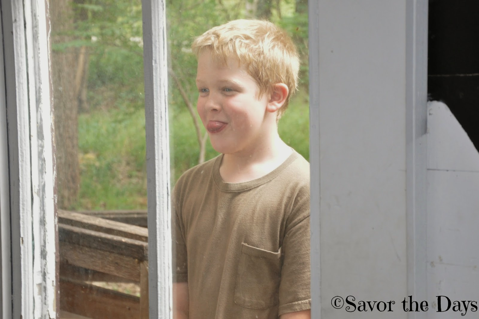 Kid taunting through window