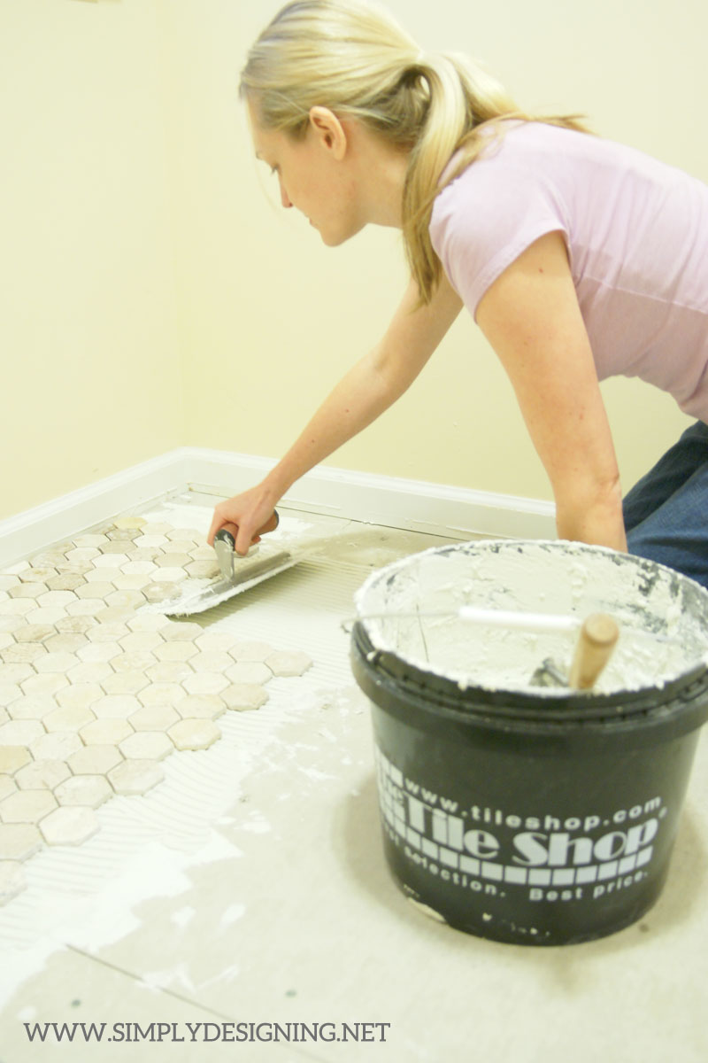 How to Install Hexagon Tile Floors: apply thinset | a complete tutorial for how to demo, prep, install concrete backer board and install new tile floors | #diy #tile #homeimprovement #hexagontile #travertine #thetileshop @thetileshop