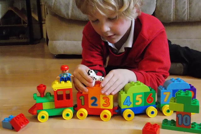 building a train out of bricks for young children