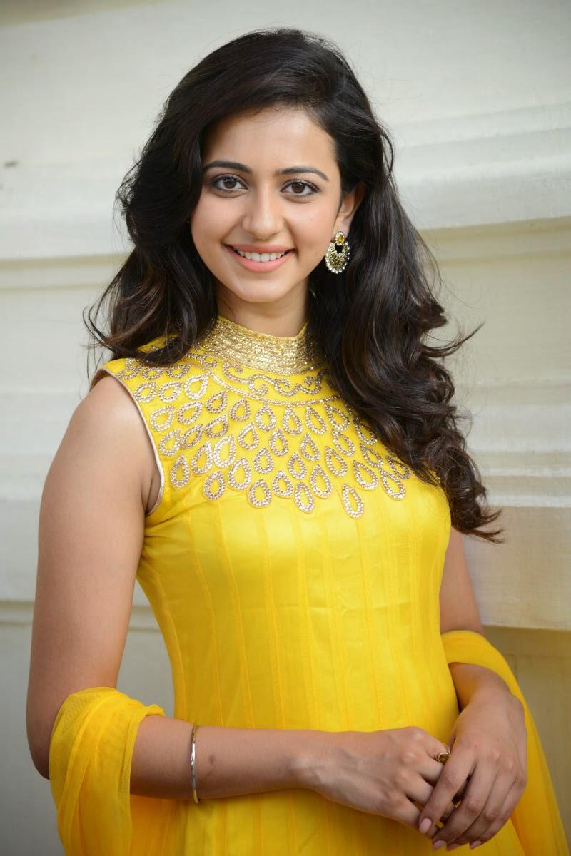 Actress Rakul Preet Singh Stills In Yellow Dress Rakul