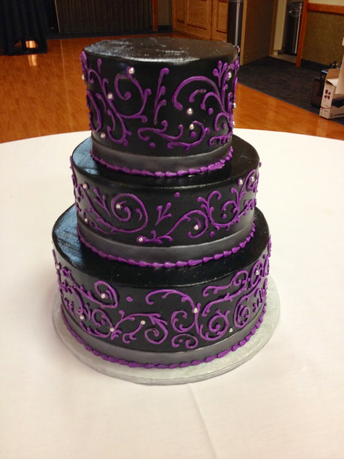 Purple and black wedding cakes