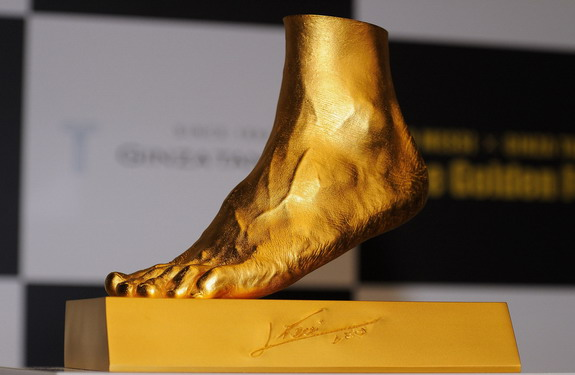 Golden statue of the left foot of Lionel Messi is displayed at the launching at Harajuku Quest Hall