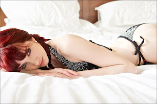 susan-coffey-laying-on-bed-in-two-cloth-photo